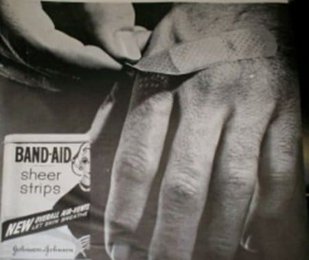 vintage band aid ad advertisement man ripping off hand