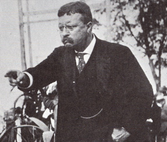 Teddy Theodore Roosevelt giving speech with pointing fingers.