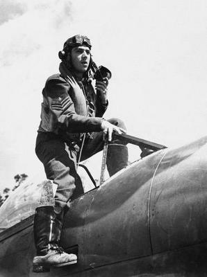 vintage pilot stepping out of aircraft airplane in uniform