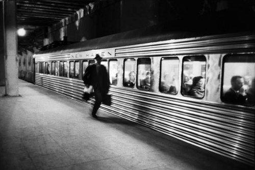 Vintage man running to catch subway train.