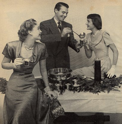 vintage party host serving drinks to ladies
