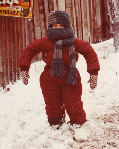 Little boy in red snow suit.