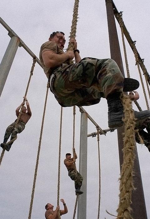 Military buds training rope climbing.