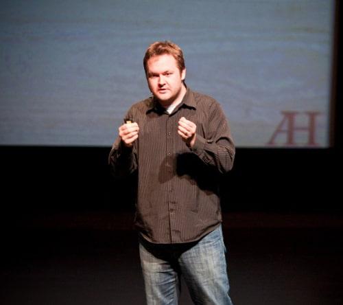 Alex Harris public speaker giving speech at stage.