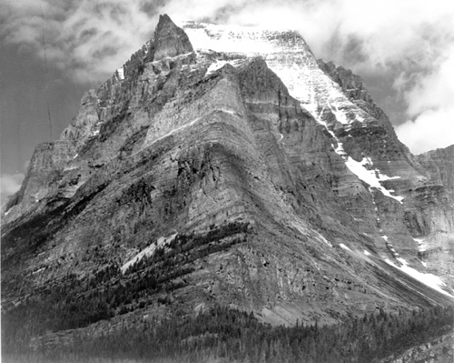 Black & white photo of Ansel Adams mountains covered with snow.