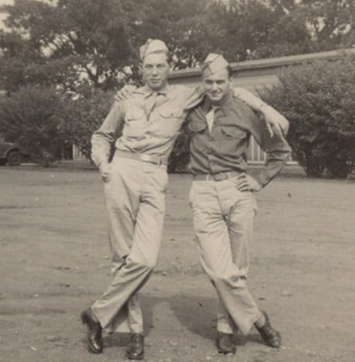 Vintage soldier friends giving side hug pose.