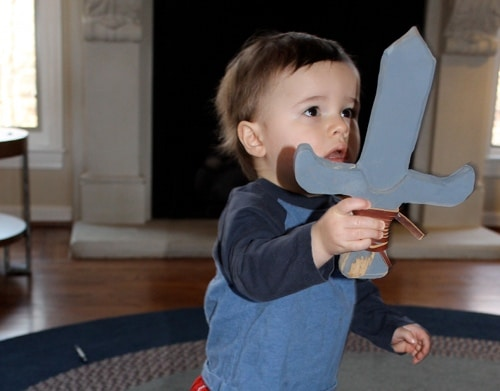 little boy with homemade diy wooden sword