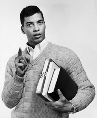 vintage african american student with books in arms