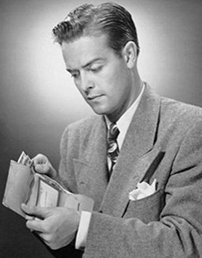 Vintage businessman in suit holding wallet and pulling the cash out.