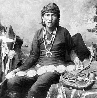 vintage native american man wearing elaborate necklace