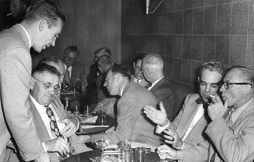 vintage businessmen at business lunch diner