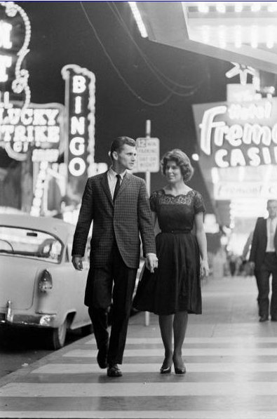 vintage couple walking downtown las vegas fremont