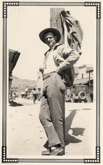 Vintage man wearing cow suit.