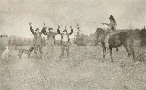 Vintage men raising their hands in front of horserider.