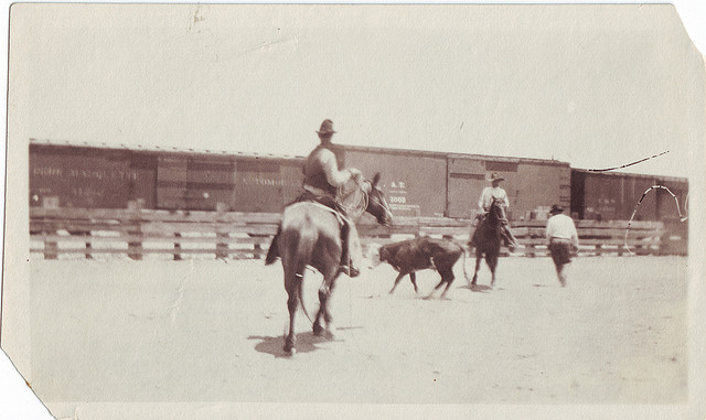 Vintage men doing horse riding in ground.