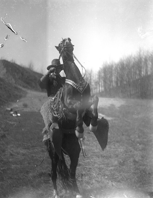 Vintage horse rider giving pose of jumping horse.