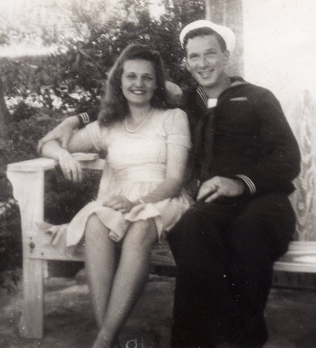 vintage couple sitting on bench sailor with gal