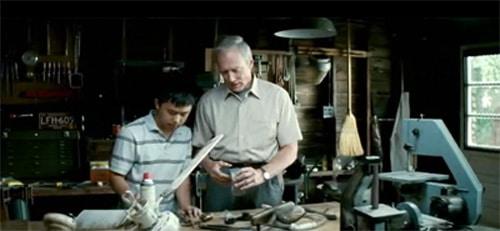 Walt Kowalski doing workshop with boy.