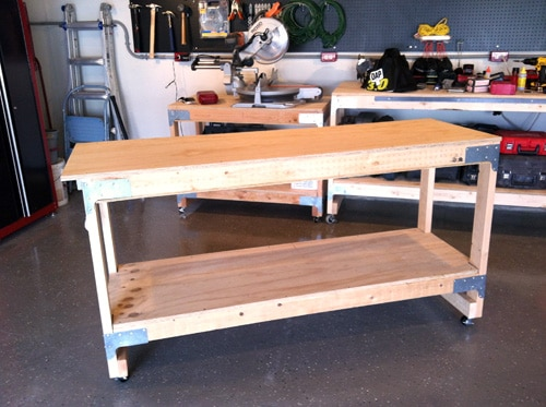 Homemade wooden bench with wheels.