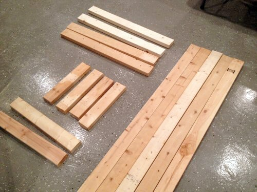 cut piles of wood for homemade diy work bench project
