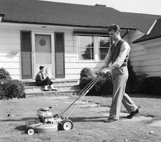 vintage man mowing lawn wife kid watching