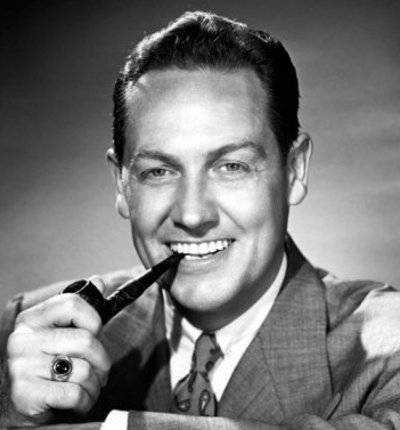 vintage man smiling smoking pipe wearing ring right hand