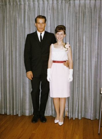 vintage young couple at prom taking portrait