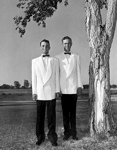 young men outdoors in white double breasted tuxedos