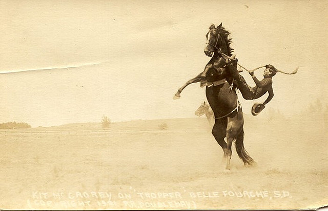 Vintage rodeo in field.