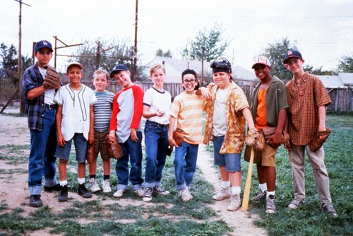Cast of sandlot movie taking a picture after playing basketball.