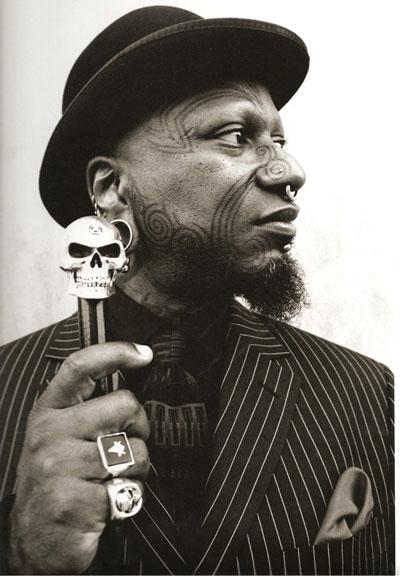 Ronni Zulu tattoo artist in suit hat.