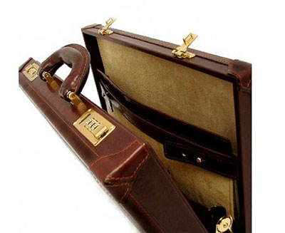Leather attache case opens with mechanical locks.