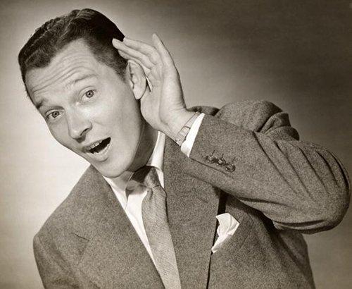 Vintage man showing gesture of listening.