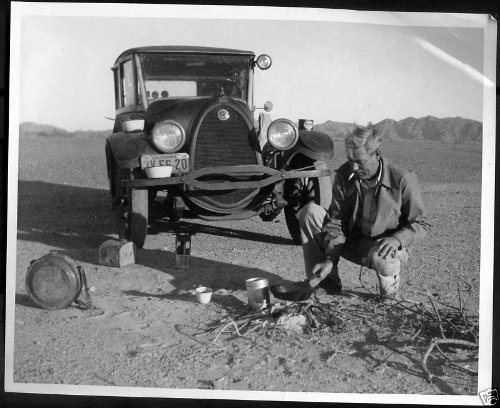 vintage 1920s 1930s man with car cooking outdoors