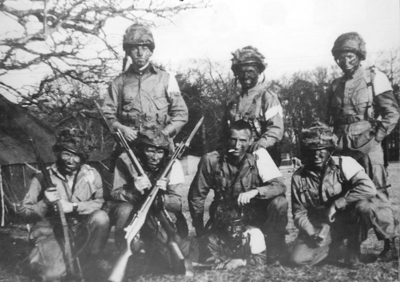 Vintage group of soldiers covered with mud in battle.