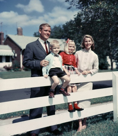 1950s 1960s Family Portrait Mother Father Daughter Son At White Fence