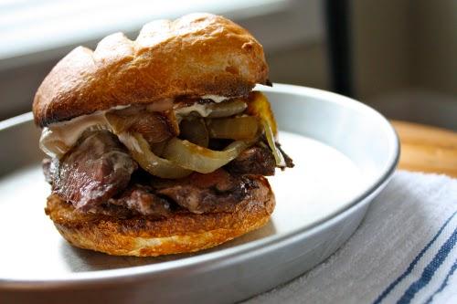 Vintage bistro steak sandwich over a plate.