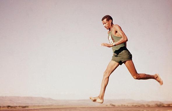 Vintage man walking while barefoot illustration.