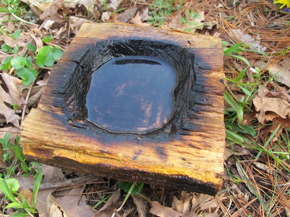 Vintage coal burning containers placed on earth.