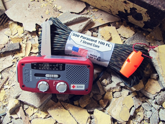 Paracord and emergency radio placed at disaster house.