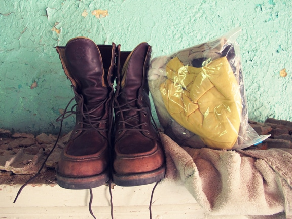 Boots and clothes placed in the disaster house.