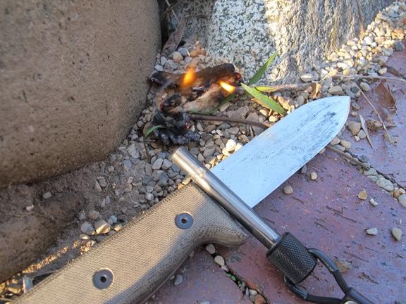 Vintage fire tinder and a knife illustration.