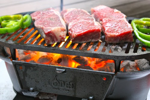 Cast Iron Grilled Strip Steaks raw meat green peppers