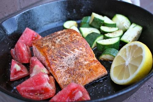 Cast iron pan seared salmon lemon zucchini.