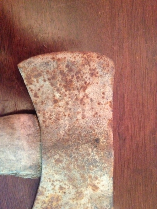 Double bit axe head worn out rusted.