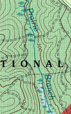 Colored topographic map with shading meaning explanation.