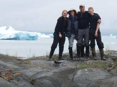 Family portrait standing on rock.