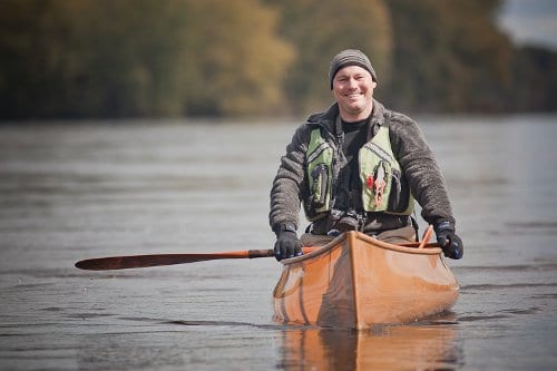 Darren Bush canoeing in the lake.