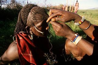 Masai men spend hours for making each other's hair.