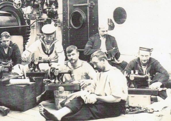 vintage sailors using sewing machines
